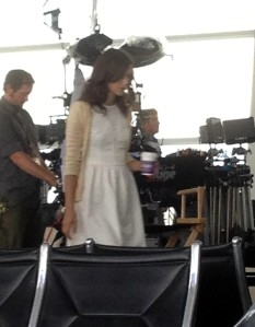 Kiera takes a break on set at Sea-Tac